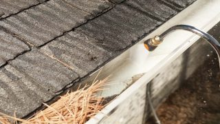 Cleaning your gutters with a pressure washer
