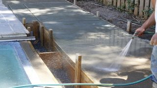 Pressure washing a concrete surface